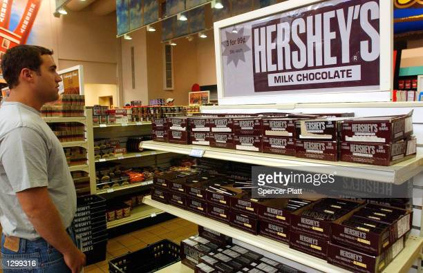 A unidentified man looks at Hershey products at a store on August 7 2002 in Hershey Pennsylvania The Hershey Trust said Wednesday after a special...