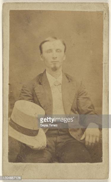 Unidentified man with goatee seated, holding a light-colored top hat on knee, Alphesu M. Lyons , 1865-1870, Albumen silver print.
