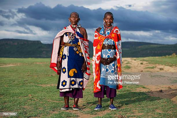 Unidentified Masai women dressed in traditional clothing along Lake Elementeita on December 12 2006 close to Soysambu farm Kenya The 55000acre farm...