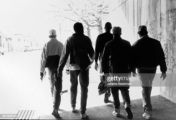 Unidentified members of BDP or Boogie Down Productions the pioneering hiphop music group walk along a street in the Bronx 1987 New York