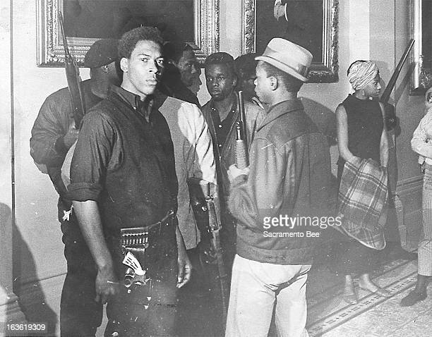 Unidentified members of the Black Panthers hold guns during the group's protest at the California Assembly in May 1967 in Sacramento California