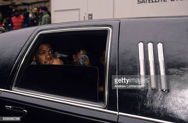 Unidentified members of the funeral caravan for rap artist Christopher Wallace known as Notorious BIG pass through the Brooklyn neighborhood of...