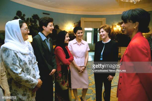 Unidentified members of the USAfghan Women's Council meet with US First Lady Laura Bush and National Security Advisor Dr Condoleezza Rice in the...