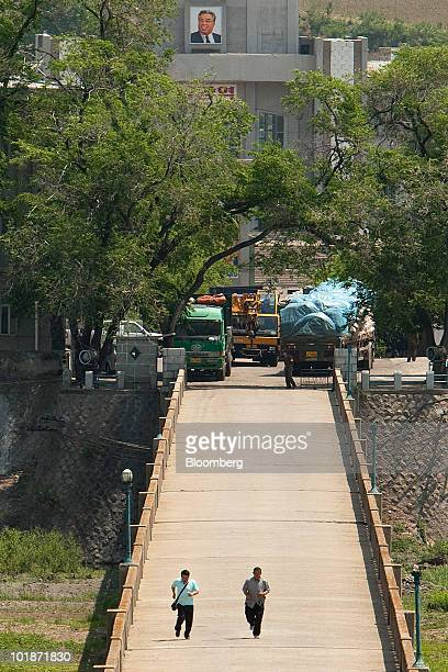Unidentified men run across a bridge for unknown reasons at a border crossing between Namyang North Korea and Tumen Jilin province China on Friday...
