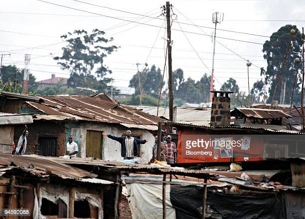 Unidentified men stand in the Kibera area of Nairobi Kenya on Friday Jan 18 2008 Kenya's opposition plans to end street protests against President...
