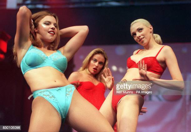 Unidentified models display the latest in lingerie on the opening day of the Erotica exhibition at London's National Hall Olympia today November 27...