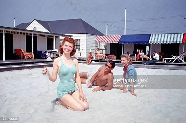 Unidentified models pose in swimwear in 1949