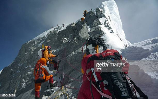 Unidentified mountaineers walk past the Hillary Step while pushing for the summit of Everest on May 19 as they climb the south face from Nepal Bad...