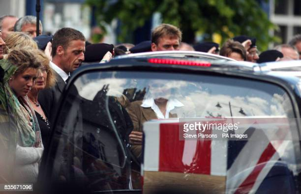 Unidentified mourners react as the coffins of Trooper Joshua Hammond 18 and Lieutenant Colonel Rupert Thorneloe are slowly driven through the town of...