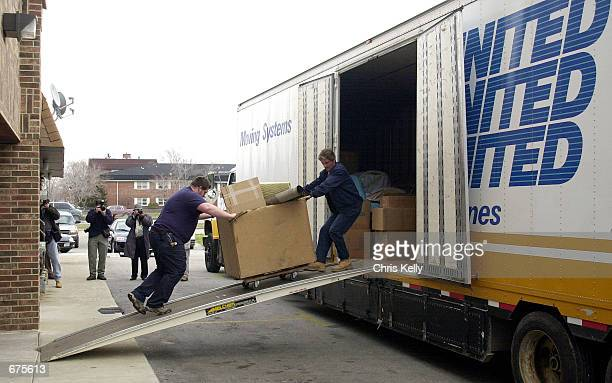 Unidentified movers remove seized assets from the Holy Land Foundation office December 4 2001 in Bridgeview IL The Department of Treasury and the FBI...