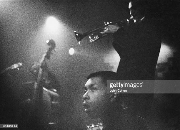 Unidentified musicians inlcuding a trumpeter and a bass violinist play jazz music at a nightclub St Mark's Place New York mid 20th Century