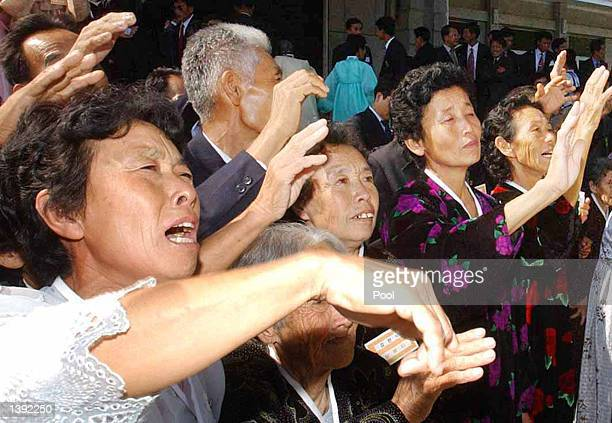 Unidentified North Koreans weep as approximately 99 South Korean visitors leave after the fifth reunion meeting of separated family members between...