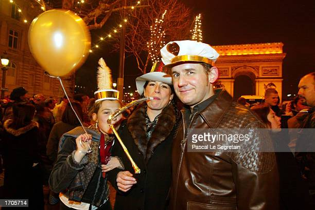 Unidentified Parisians celebrate New Year's Eve on the Champs Elysees December 31 2002 in Paris France
