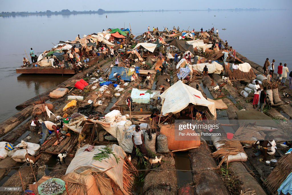 Congolese Suffer In Poor Conditions Traveling By Boat : News Photo