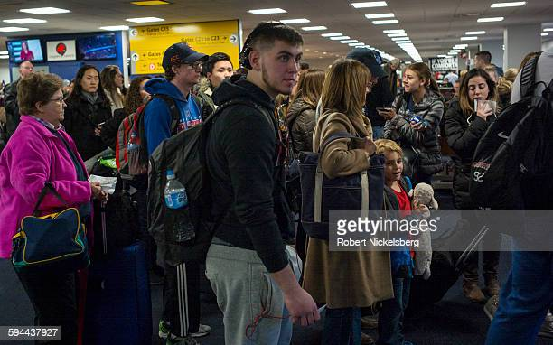 Unidentified passengers traveling on a Delta Airlines domestic flight wait to board their flight at LaGuardia Airport in New York City on November 29...