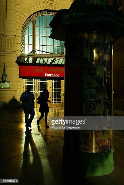 Unidentified pedestrians walk past a kiosk in front of the Paris hotel on Las Vegas Boulevard on September 17 in Las Vegas
