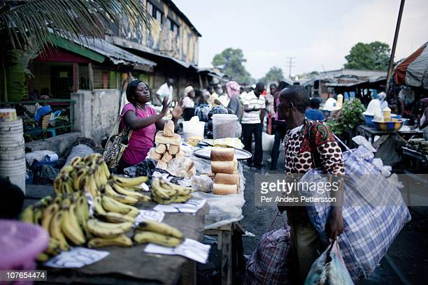 Unidentified people at an evening street market on November 3 2010 in the Gombe district in central Kinshasa Congo DRC Kinshasa a city of about eight...