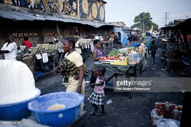 Unidentified people at an evening street market on November 3, 2010 in the Gombe district in central Kinshasa, Congo, DRC. Kinshasa, a city of about...