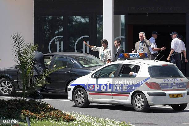Unidentified people leave the hotel Pullman where some relatives of passengers of the Air France plane which dropped off radar over the Atlantic...