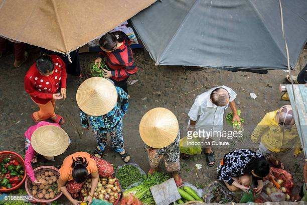 HO CHI MINH CITY, VIETNAM - APRIL 26TH 2016: Unidentified People trading vegetables and fruits at street market of Saigon