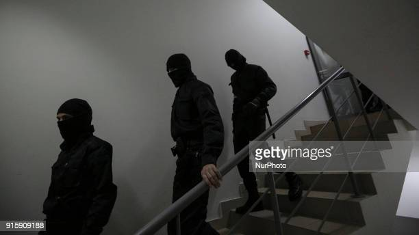Unidentified people wearing the uniform with no insignias walks downstairs 32nd floor of a business center quotGulliverquot Few groups of police...