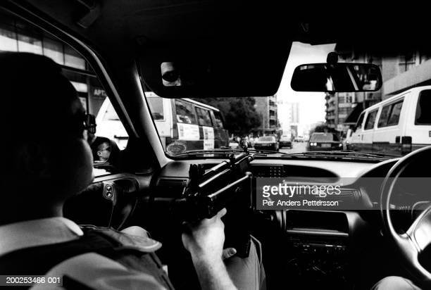 Unidentified police officers patrol a crimeinfested area with automatic rifles on November 5 1998 in Hillbrow Johannesburg South Africa Flying Squad...