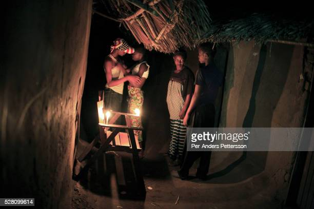 Unidentified prostitutes negotiate with clients in a brothel on March 27 2006 in Bumba Congo DRC Men only frequent the bar and they serve homemade...