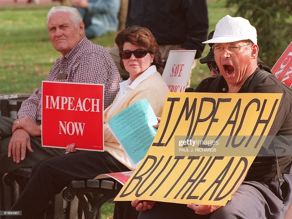 Unidentified protestors demanding the impeachment of US President Bill Clinton conduct their noontime protest from the park benches in Lafayette Park across from the White House 07 December. Clinton's lawyers 'will present a case that is robust' in up to 30 hours of hearings Tuesday and Wednesday before the House Judiciary committee on Capitol Hill. AFP PHOTO/Paul J