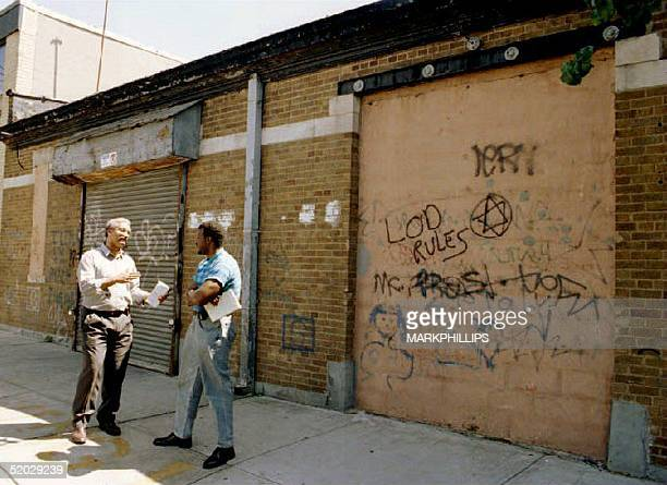 Unidentified reporters stand outside a garage in the Jamaica, Queens section of New York City where six Moslem fundamentalists were arrested while...