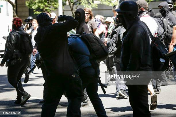 Unidentified Rose City Antifa members beat up Andy Ngo a Portlandbased journalist on June 29 2019 in Portland Oregon Several groups from the left and...