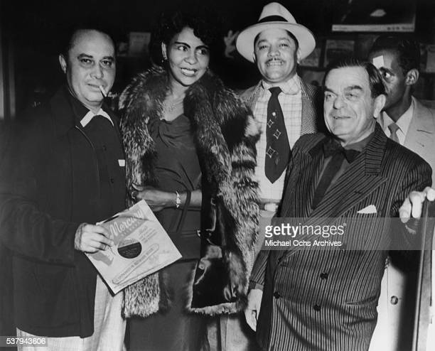 Unidentified singer and pianist Camille Howard Record producer and records store owner John Dolphin and Mark Hurley at 'Dolphin's of Hollywood' in...