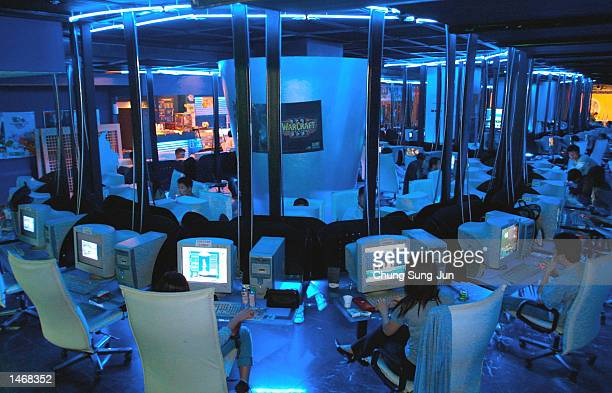 Unidentified South Korean teenagers and students play computer games in an RA PC Zone October 10 2002 in Pusan south of Seoul South Korea The PC Zone...