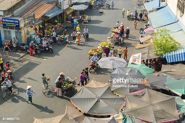 HO CHI MINH CITY, VIETNAM - APRIL 26TH 2016: Unidentified Street vendor trading vegetables and fruits at street market of Saigon
