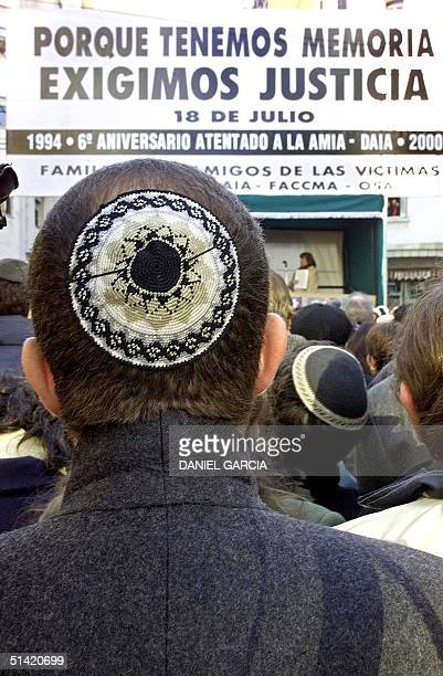 Unidentified supporter listen the speech during the sixth anniversary act of the attack by AMIA 18 July 2000 in front of the new building of the...
