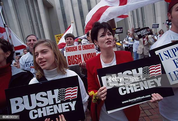 Unidentified supporters for Governor George W Bush and Dick Cheney cheer outside the Seminole County court house in Tallahassee Florida as the...