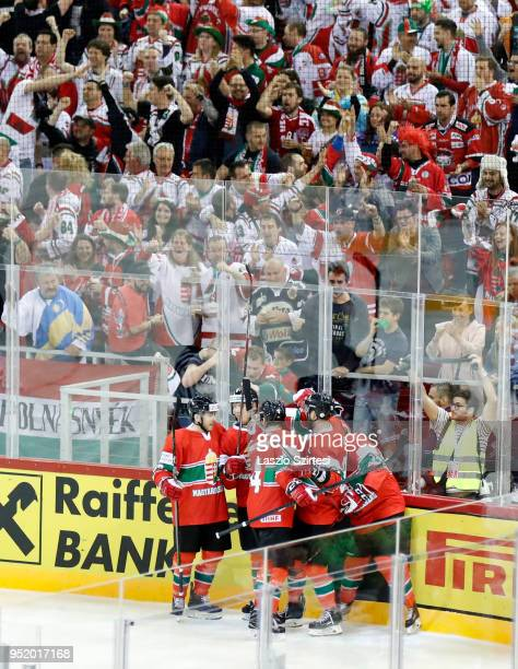 Unidentified teammates of Hungary celebrate the first goal during the 2018 IIHF Ice Hockey World Championship Division I Group A match between Poland...