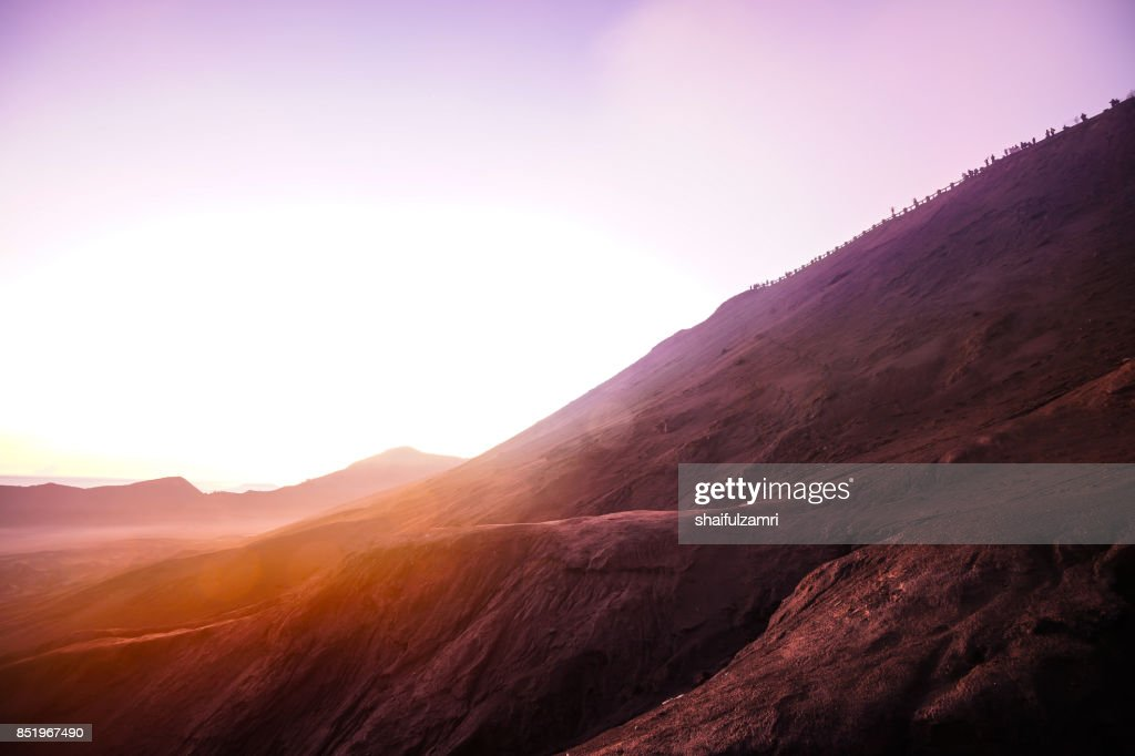 Unidentified tourists gather near Mt.Bromo in early morning for ritual spirit from local people : Stock Photo