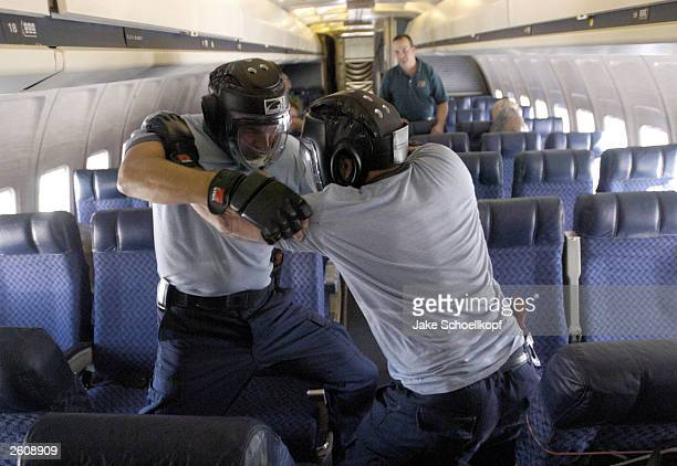Unidentified United States commercial airline pilots practice defensive tactics on board a Boeing 727 at the Federal Law Enforcement Training Center...