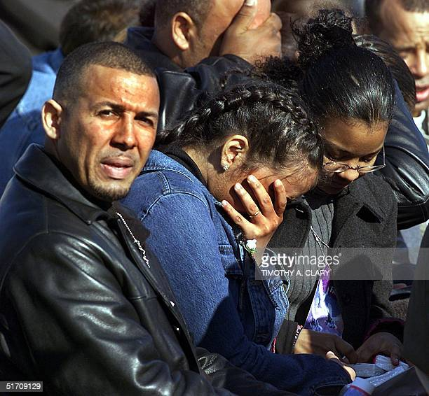 A unidentified woman is comforted during a ceremony held at Riis Park in Rockaway Beach 18 November for the family members of the people that were...