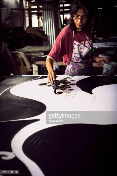 "unidentified woman use dye to make a ""batik"" - shaifulzamri stock pictures, royalty-free photos & images"