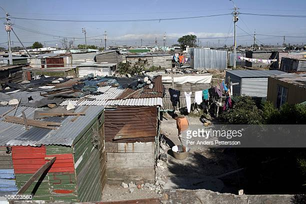 A unidentified woman washes her laundry outside her tin shack on December 14 In the Barcelona section of Guguletu a township outside Cape Town South...