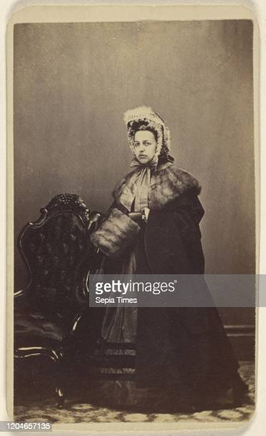 Unidentified woman wearing an elegant outfit complete with fur muff standing LT Sparhawk 18701879 Albumen silver print