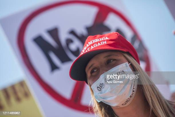 A unidentified woman wears a face scarf as a preventive measure against the spread of the COVID19 Coronavirus while she gathers a demonstration on...