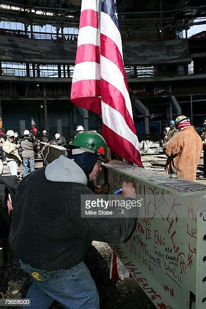 Unidentified worker signs his name to the steel beam that will be raised to the highest structural point during a topping off ceremony at the...