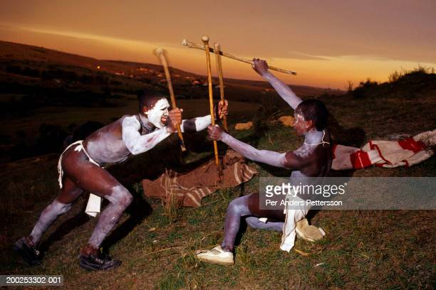 Unidentified Xhosa boys practice traditional spear fighting as they are going trough a traditional manhood ceremony on August 21 2000 in Tshatshu...
