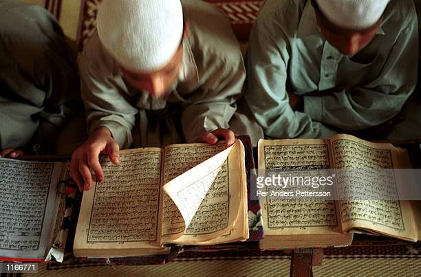 Unidentified young boys read the Koran at a Koranic school or Madrassa September 24, 2001 in Rawalpindi, Pakistan. The students, age 5-18, come from...