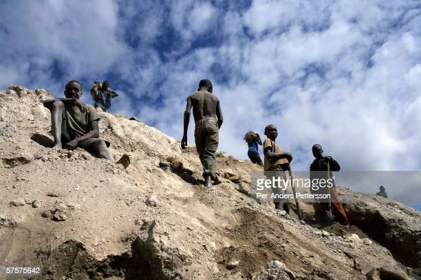 Unidentified young boys works among about 4000 artisan miners digging copper on December 13 2005 in Ruashi mine about 20 kilometers outside...