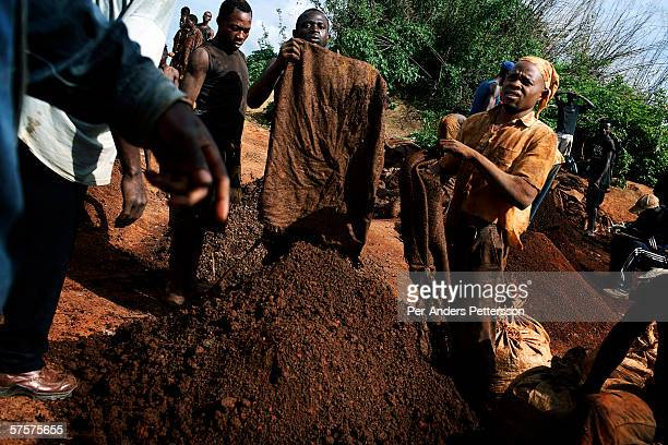 Unidentified young men workin a cobalt mine on December 13 2005 in Ruashi mine about 20 kilometers outside Lubumbashi Congo DRC Children as young as...