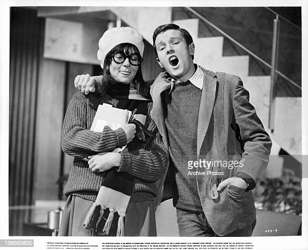 Unidentified young woman and man walking together in a scene from the film 'Dear Heart', 1964.