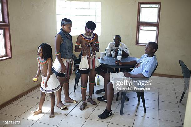 Unidentified youth socialize at the Royal Palace on August 31 in Ludzidzini Swaziland About 80000 virgins from all over the country attended this...